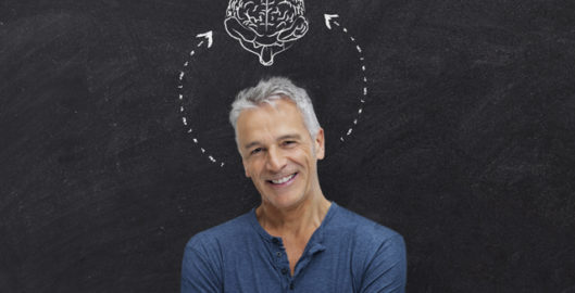 cubex hearing brain mature man in front of blackboard